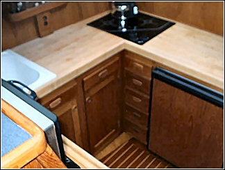 custom boat interior including full kitchenette